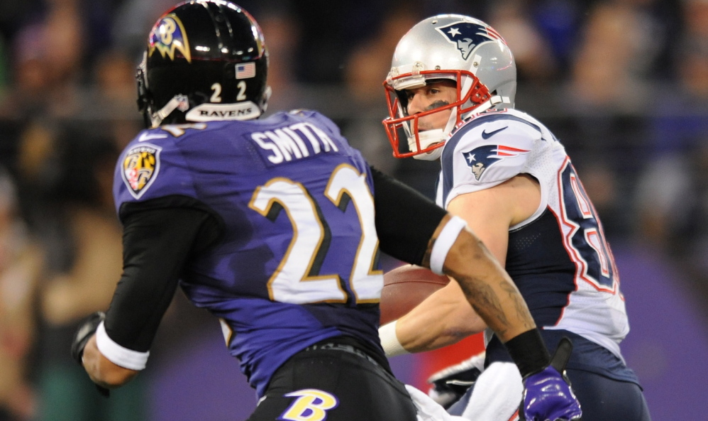 Receiver Danny Amendola rushes past Baltimore cornerback Jimmy Smith for good yardage during the first half of Sunday's game.