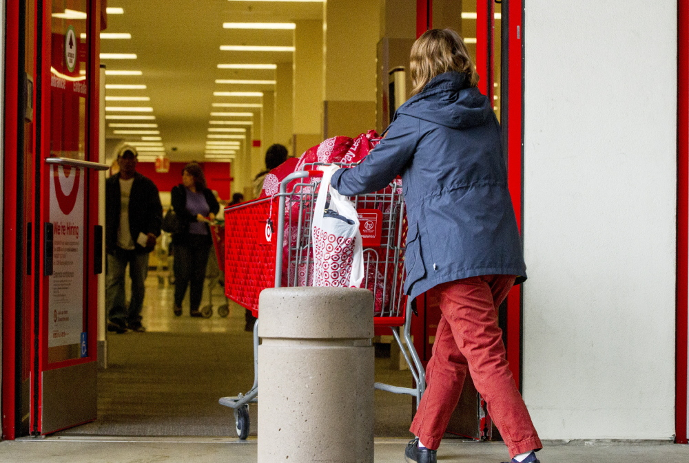 Shoppers arrive at a Target store in Los Angeles late last week. The retailer's data breach exposed debit and credit card information of 40 million customers who bought merchandise in U.S. Target stores from Nov. 27 to Dec 15.