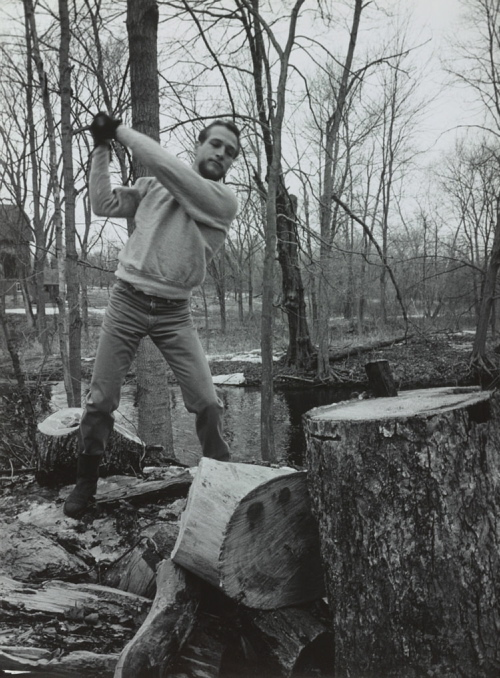"""Paul Newman Chopping Wood,"" 1963, by Phillipe Halsman is part of the new exhibition ""American Vision: Photographs from the Collection of Owen and Anna Wells"" at the Portland Museum of Art."