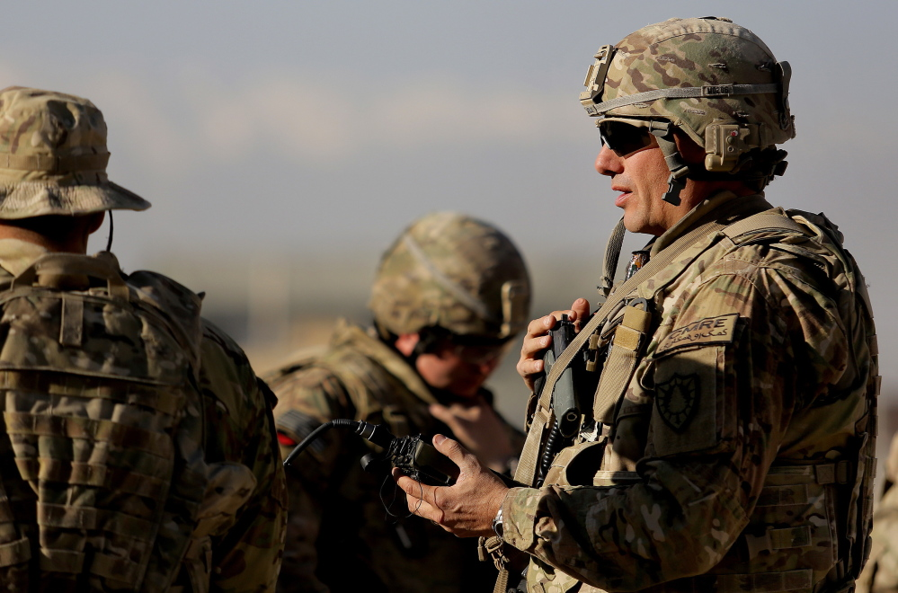 Sgt. Todd Mills of Gorham, who traded his portfolio manager suit and tie for fatigues and body armor, prepares Thursday for battle drills with the 133rd Engineer Battalion in Afghanistan.