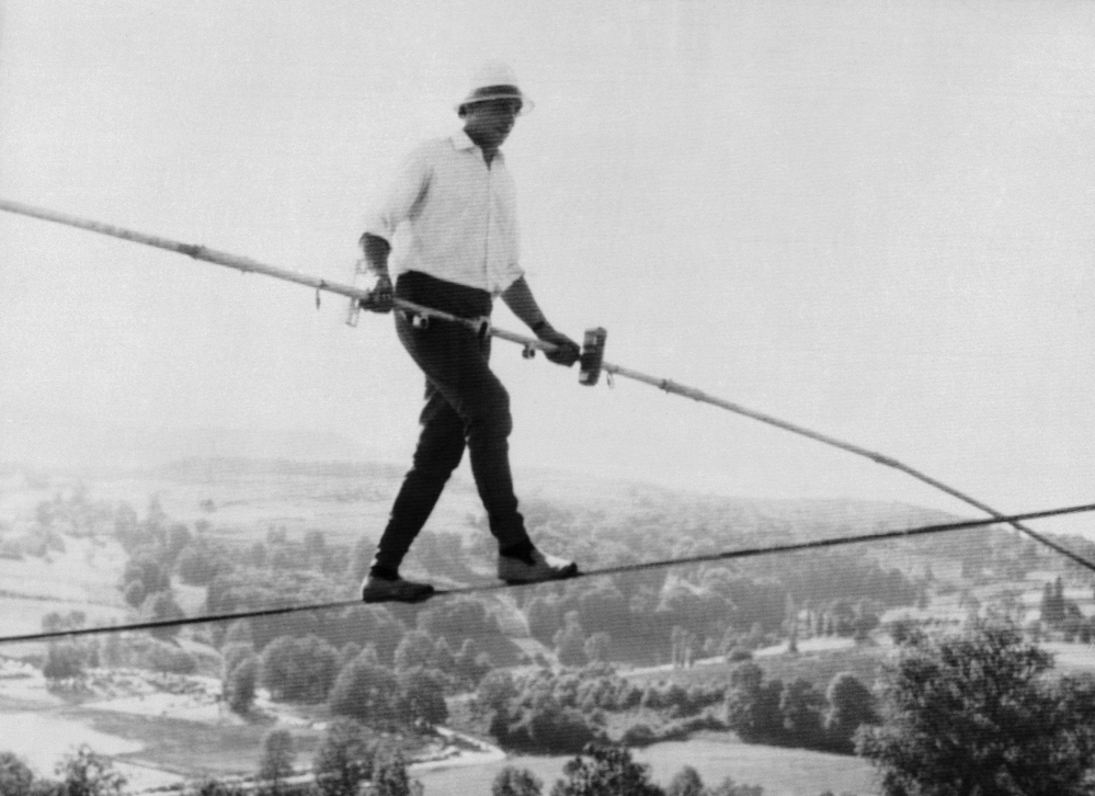 French tightrope walker Henri Rechatin walks over the Saint-Remy sur Durolle countryside in central France, in this July 16, 1967 file photo, as he breaks the specialty's world record of the time. The celebrated French tightrope walker known as Henry's, who balanced above high the Alps, the Grand Canyon and Niagara Falls, died on Friday, aged 82, the mayor of his home town of St Etienne announced Saturday.