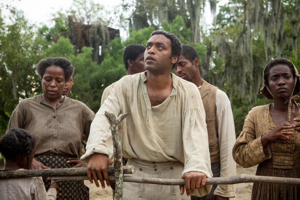 """12 Years a Slave,"" starring Chiwetel Ejiofor, center, is among several films directed by black filmmakers and/or starring black actors that are expected to be in the Oscar race this year."