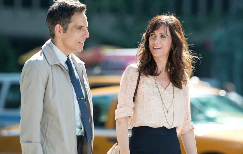 Mitty works up his courage to ask out a colleague played by Kristen Wiig, right.