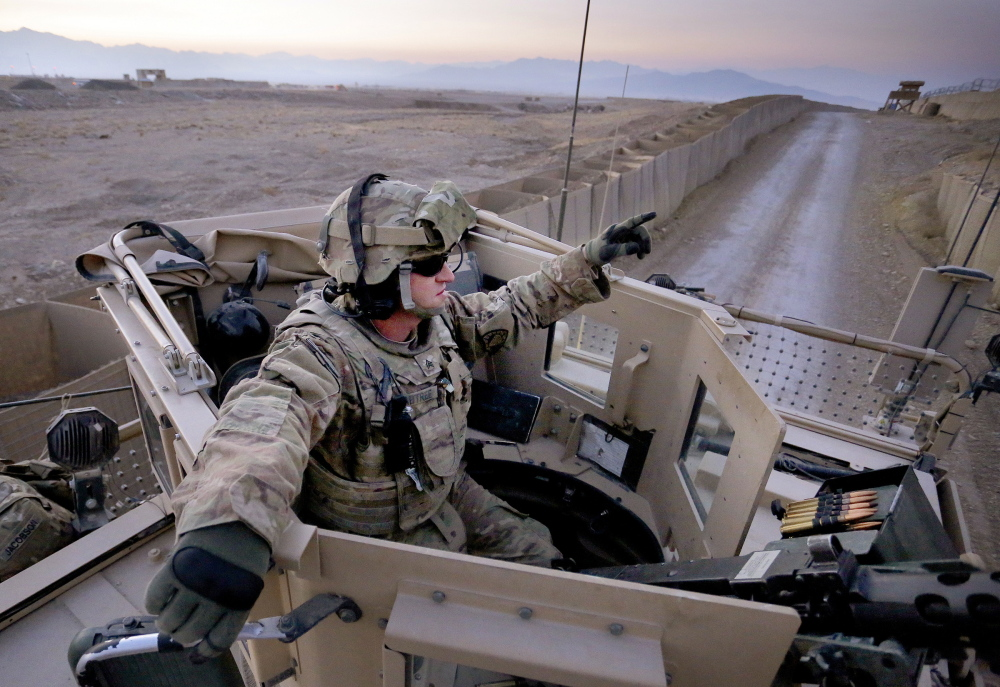 Sgt. Eric Crabtree of Hope, a gunner with the Maine Army National Guard, rides in a gun turret at Forward Operating Base Shank shortly before his convoy left for Bagram last Monday.