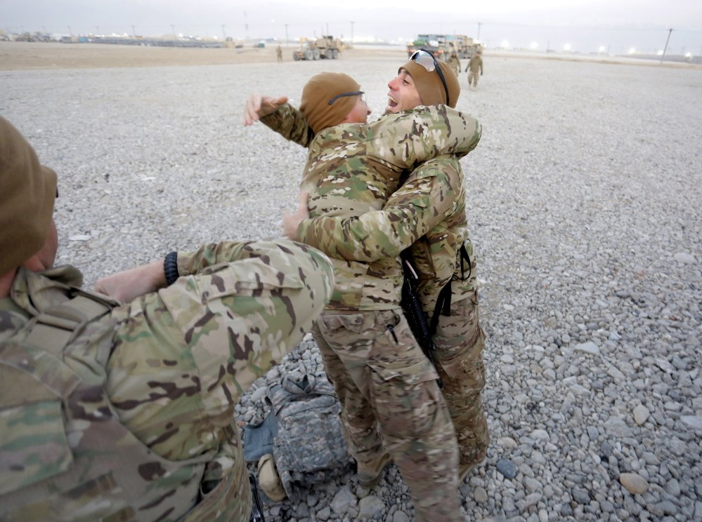 Sgt. 1st Class Kameel Farag of Oakland, right, welcomes 1st Sgt. Andrew Pattle of Harrison and other members of the Convoy Escort Team back to Bagram Air Field on Dec. 24.