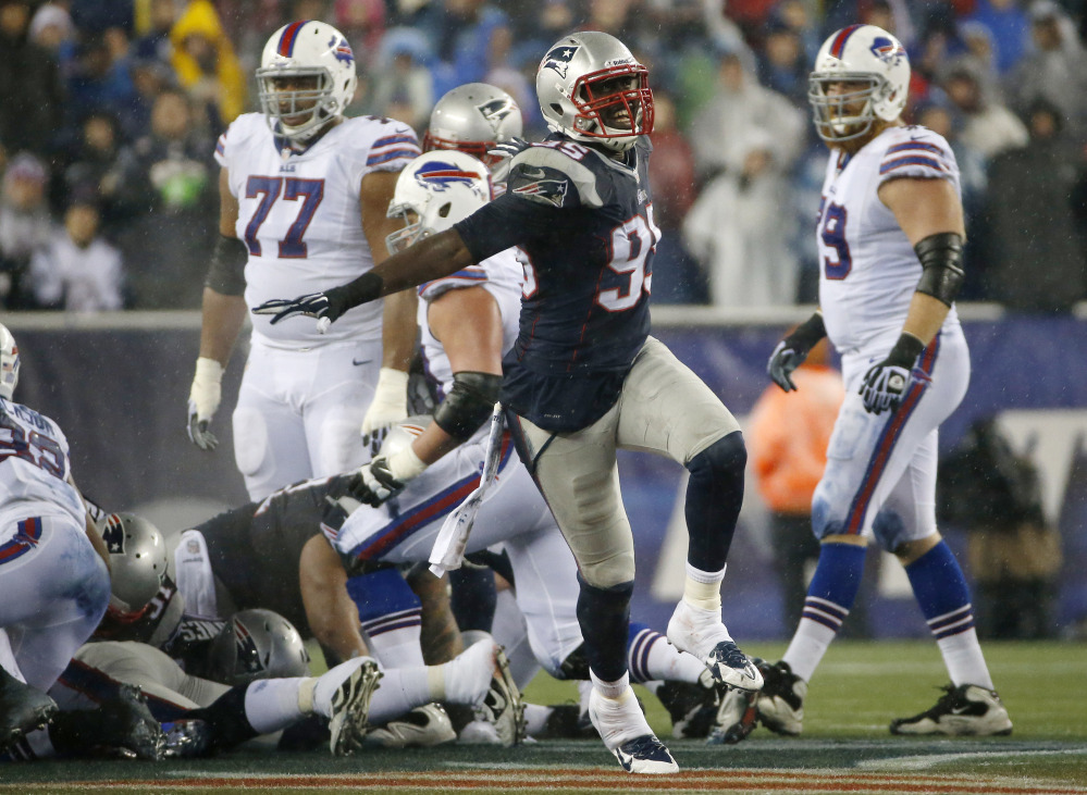 New England Patriots defensive end Chandler Jones (95) celebrates after the Patriots stopped the Buffalo Bills on fourth down during a drive in the second quarter of an NFL football game, Sunday, in Foxborough, Mass.