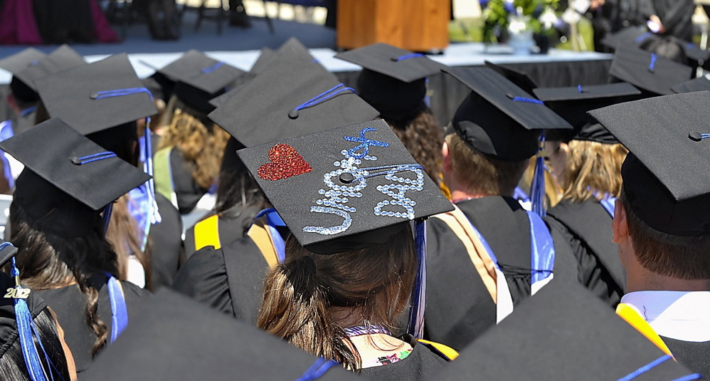 A senior sends a message to her parents during the 2012 graduation ceremonies at Saint Joseph's College. A new survey aims to figure out what people get out of college, in both tangible and intangible ways.