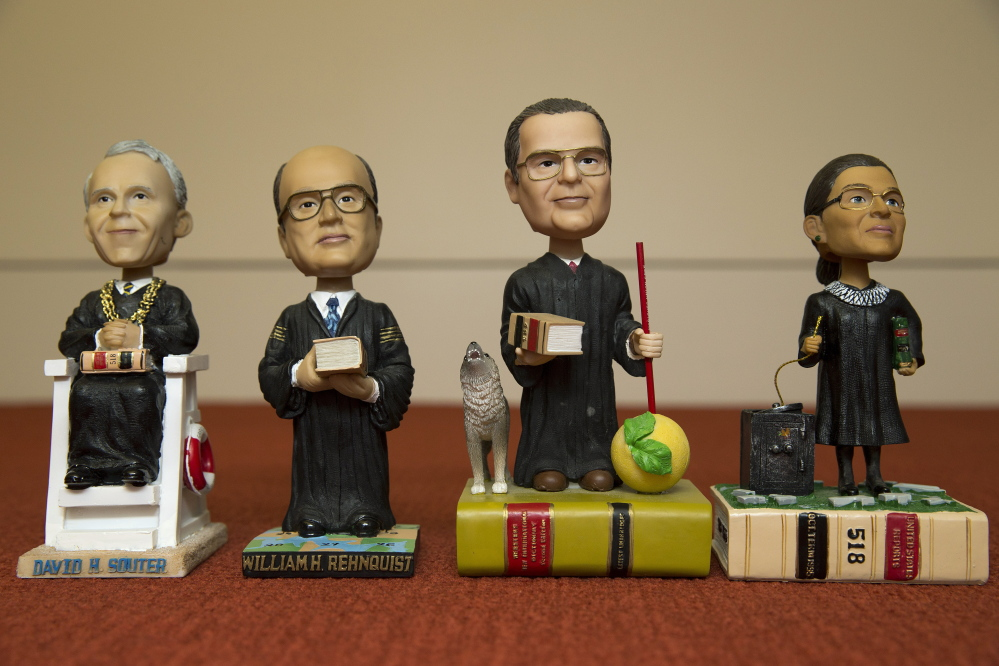 Bobblehead figures representing Supreme Court justices, from left, David Souter, William Rehnquist, Antonin Scalia and Ruth Ginsburg, are shown in a Nov. 20 photo. Given away, not sold, they are treasured by the justices and coveted by fans.