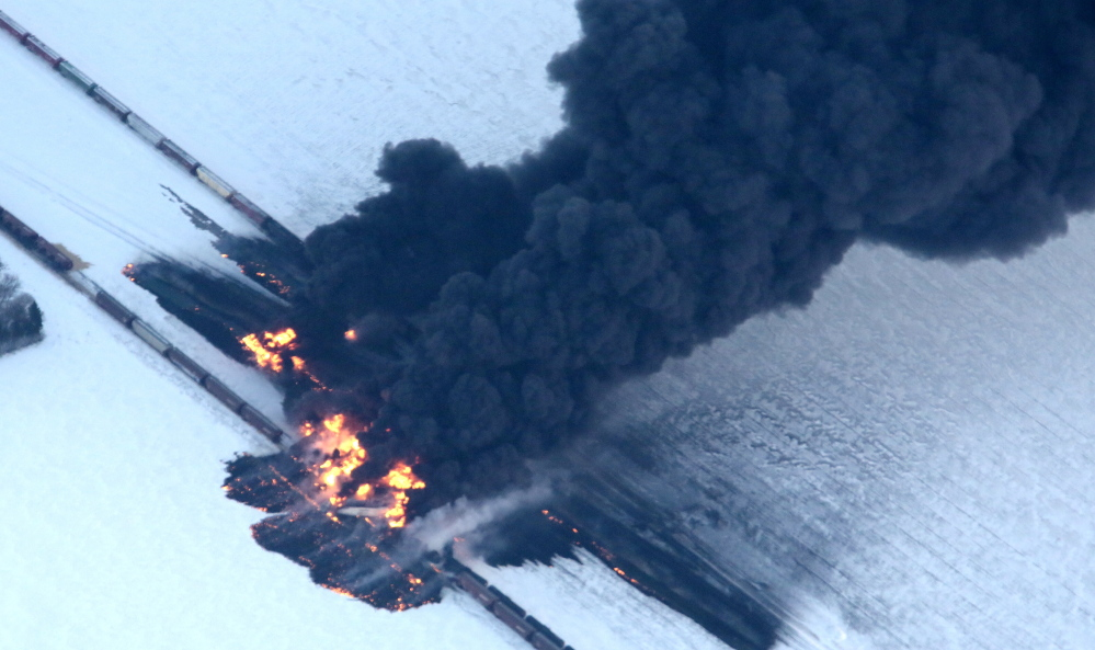 Fire from an oil train derailment burns uncontrollably Monday as seen in this aerial photograph taken west of Casselton, N.D. No one was reported hurt in the derailment or fire, but officials were evacuating people as a precaution.