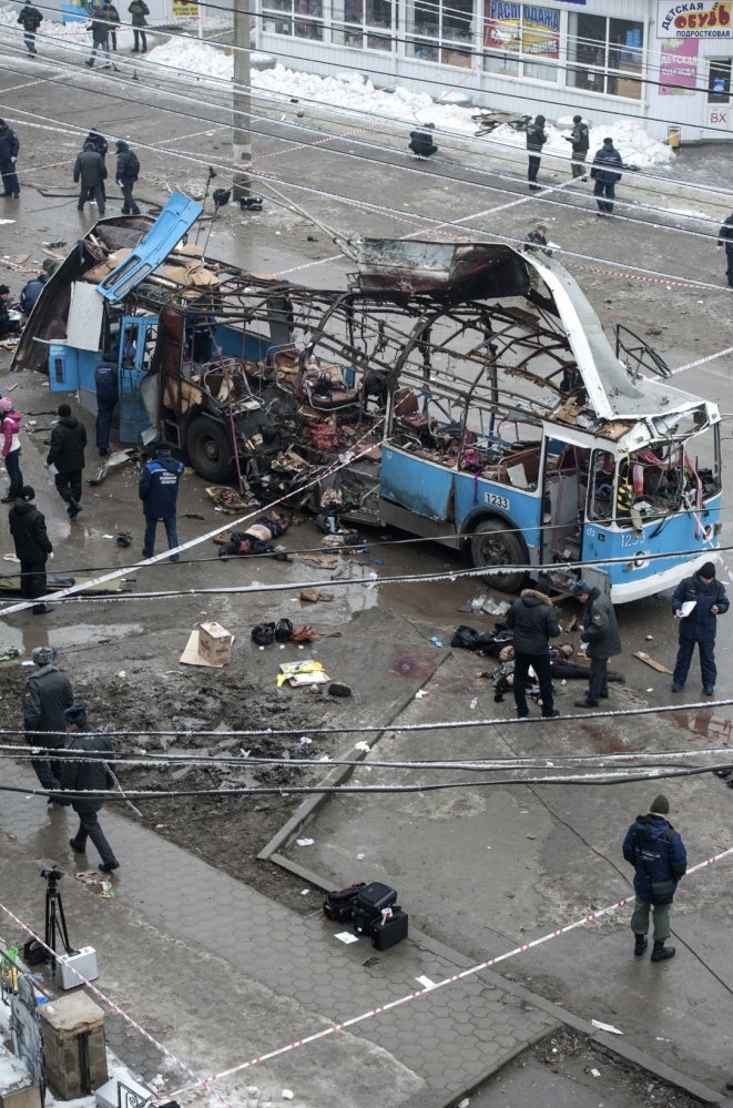 Investigators go through the wreckage of a bus destroyed by a suicide bomber in Volgograd on Monday, killing 14. A bombing the day before killed 17 in the city.