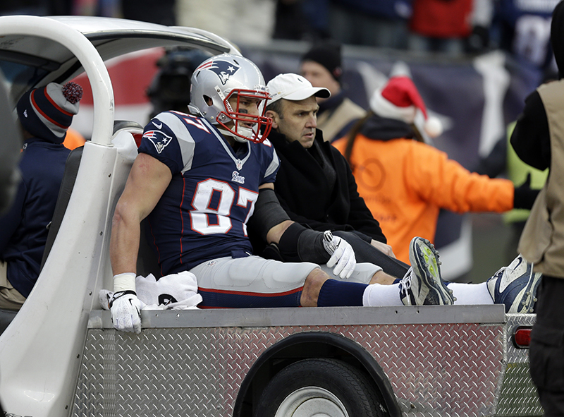 New England Patriots tight end Rob Gronkowski leaves the field in a cart after being injured in the third quarter against the Cleveland Browns Sunday in Foxborough, Mass.