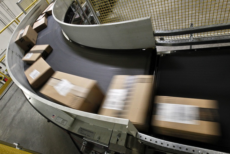 Packages move along a conveyor belt at the Amazon.com fulfillment center in Phoenix. U.S. online sales, including those made on Cyber Monday, are expected to hit a new record in the 2013 holiday season, providing another avenue for retailers to lock in sales but exposing shoppers to more cybersecurity hazards.