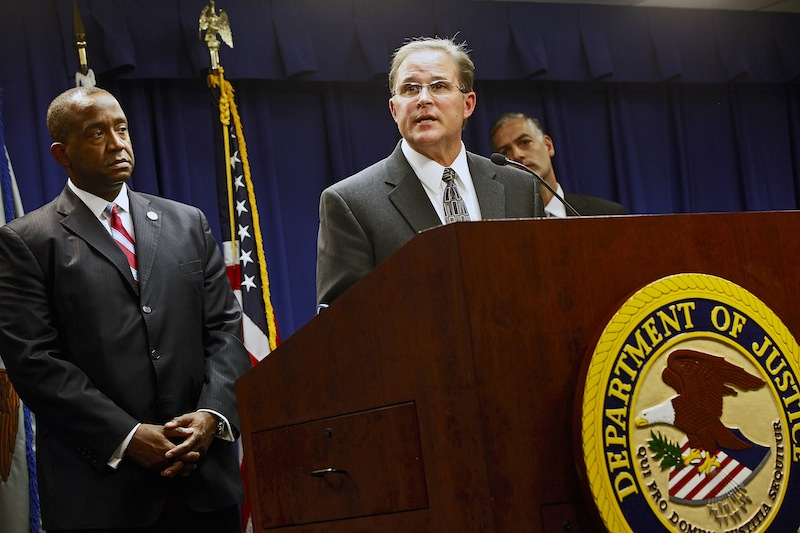 Bill Lewis of the FBI's Los Angeles Division, at podium, comments on the five criminal cases filed against 18 current and former Los Angeles County sheriff's deputies as part of an FBI investigation into allegations of civil rights abuses and corruption in the nation's largest jail system. At left is Andre Birotte, U.S. Attorney for the Central District of California.