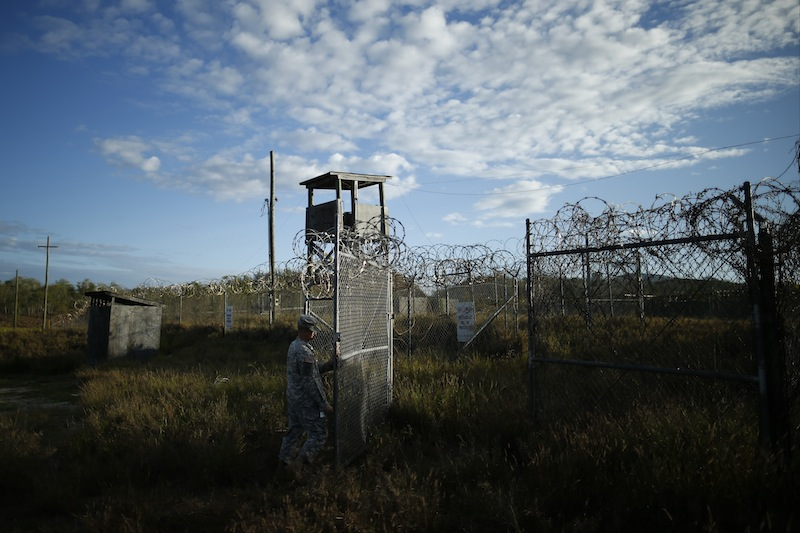 A soldier closes the gate at the now abandoned Camp X-Ray at Guantanamo Bay Naval Base, Cuba, which was used as the first detention facility for al-Qaida and Taliban militants who were captured after the Sept. 11 attacks.