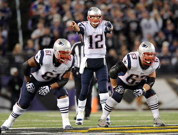 New England Patriots quarterback Tom Brady directs his teammates before running a play in the first half of Sunday's game against the Baltimore Ravens. The Patriots routed the Ravens, 41-7.