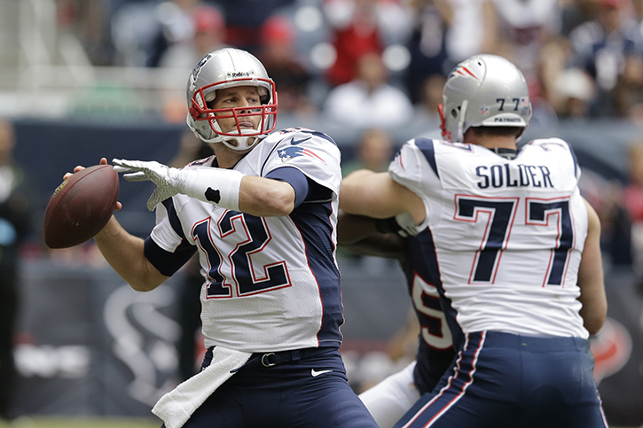 Patriots quarterback Tom Brady gets ready to throw a pass during the first quarter of the game against the Houston Texans Sunday. New England overcame a 24-point first-half deficit last week to beat the Broncos 34-31 in overtime.