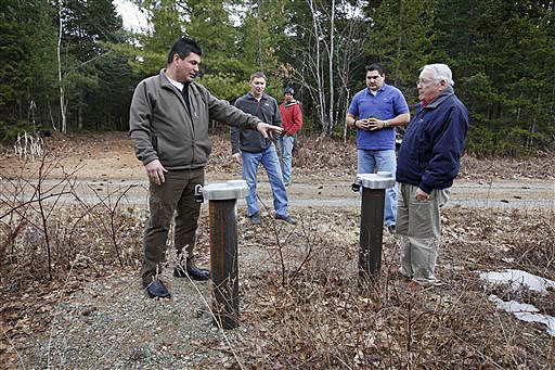 Michael Dugay, a consultant for the Passamaquoddy tribe, left, and Chief Joseph Socobasin lead a group visiting a spring water well site on tribal land in Indian Township. The tribe is planning to build a bottling plant with the goal of bottling 10 million cases of water by the third year of operation.