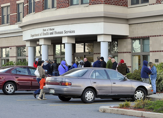 People line up outside the DHHS Building on Marginal Way in Portland before it opens in this October 2010 photo. DHHS offices have been on Marginal Way for the past 20 years and have been in the city even longer.