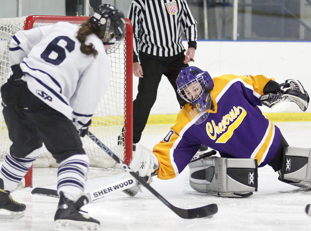 Taylor Courtois of Cheverus tries to make a save on a shot by Callie Sturgeon of Portland/Deering, who scored on a power play during the third period of the City Cup girls' hockey game Wednesday at the Portland Ice Arena. Cheverus won, 5-2.