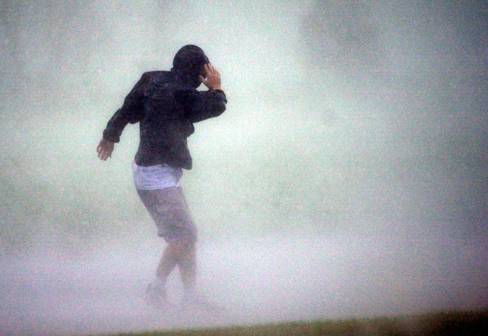 Dave Martin took this photo of a man as Hurricane Lili neared landfall in New Iberia, La., in 2002.