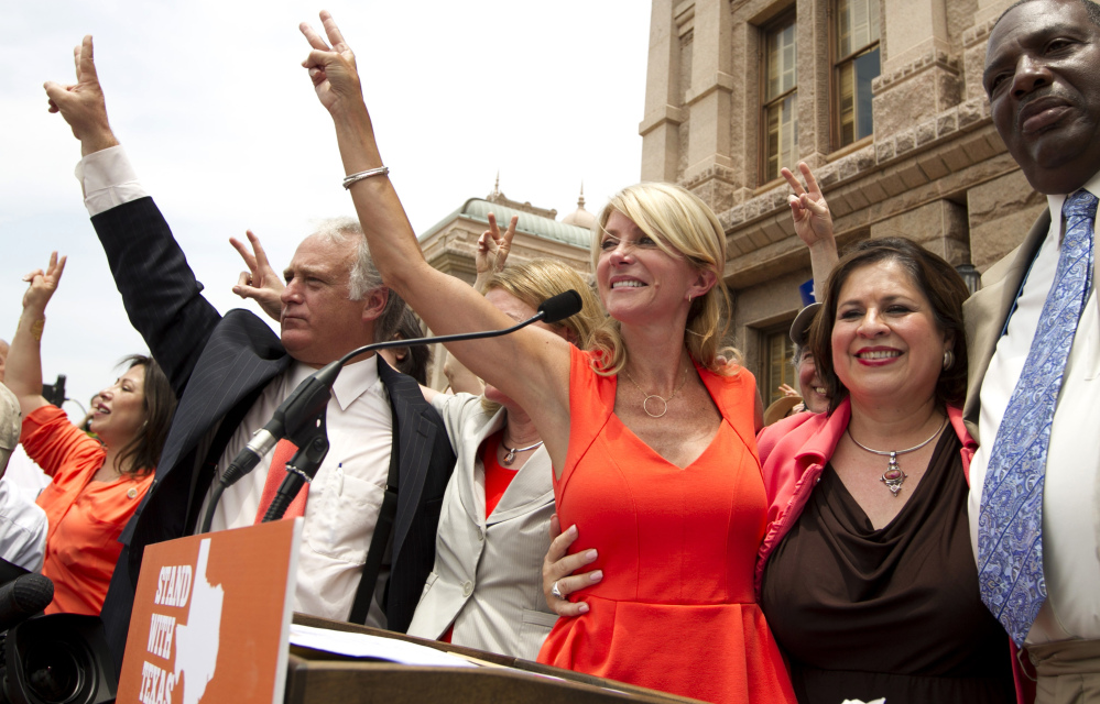 Democratic state senators, from left, Kirk Watson, Wendy Davis, Leticia Van de Putte and Royce West attend a pro-abortion rights rally in Austin in July. Davis and Van de Putte are going for a new kind of history, hoping to win as an all-female ticket for governor and lieutenant governor.