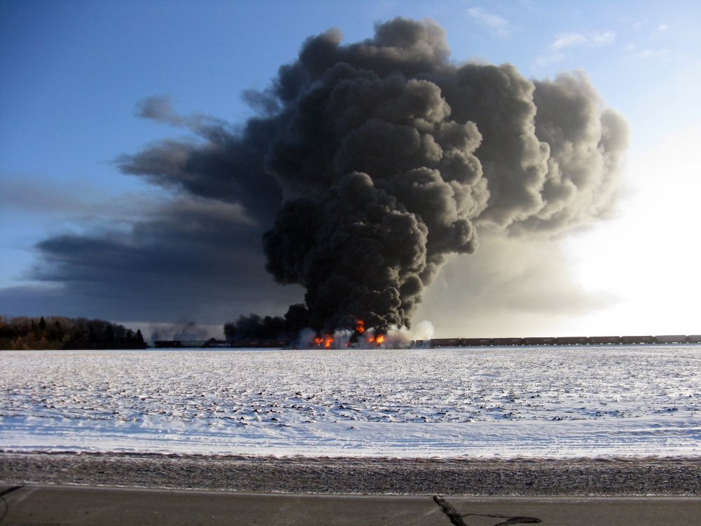 The Associated Press Smoke billows from a train derailment and fire west of Casselton, N.D., Monday.