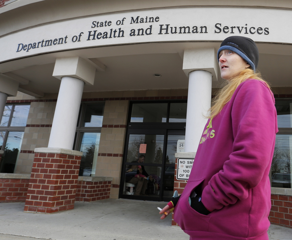 Lisa Harmon of Westbrook outside the state Department of Health and Human Services office on Marginal Way in Portland in November. The state has signed a contract to move to offices in South Portland.