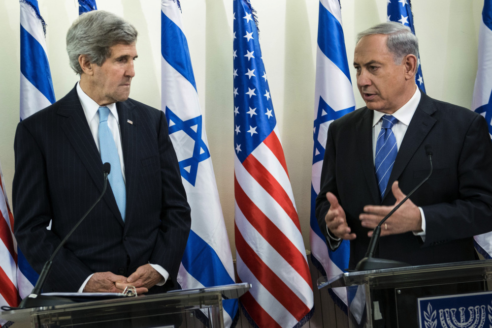 U.S. Secretary of State John Kerry, left, listens as Israeli Prime Minister Benjamin Netanyahu makes a statement during a news conference before their talk at the prime minister's office in Jerusalem on Thursday.