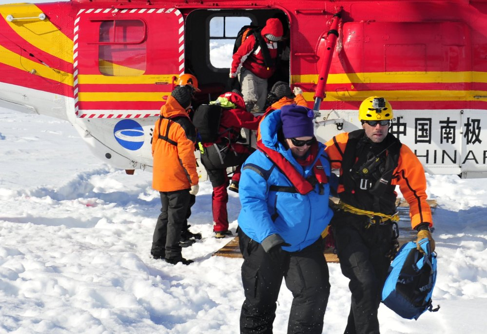 The first passengers of the trapped Russian ship MV Akademik Shokalskiy reach safety off the Antarctic Thursday.