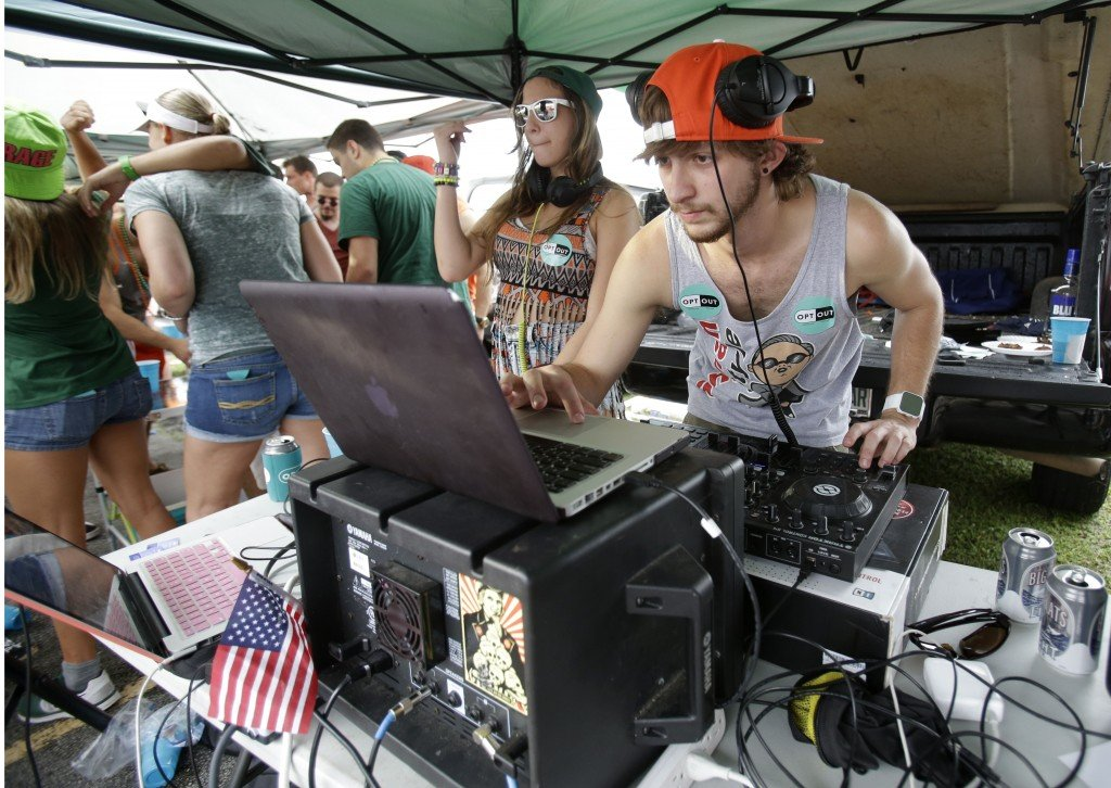DJs ZAZ, left, and Joseph Michael provide music before a football game in November between Miami and Virginia Tech in Miami Gardens, Fla., at a tailgate party sponsored by Generation Opportunity, a conservative organization that encouraged students to opt out of the Affordable Care Act.