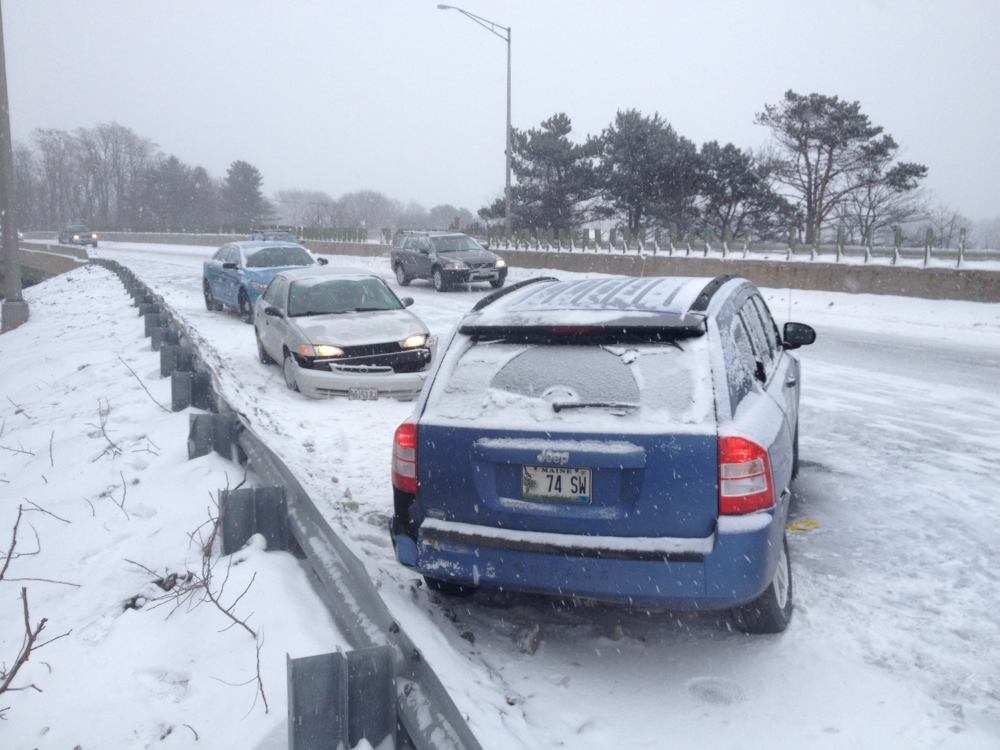 Gordon Chibroski/Staff Photographer A crash in Falmouth slowed drivers during this morning's commute on I-295.