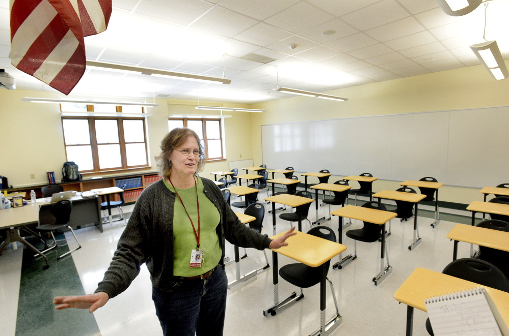 Rose Kennealy, a math teacher, says she is excited about her new classroom in the South Portland High School addition, which features radiant heat underneath the flooring.
