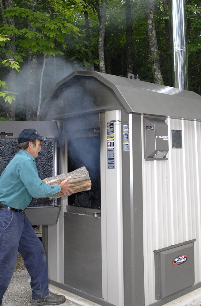 A load of hardwood with some pine will last about 24 hours in this wood boiler in Gray, shown in 2008.