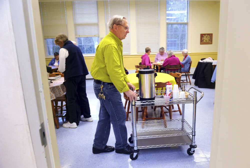 "Donald Darling, 75, clears the coffee station, part of his regular duties as maintenance man at the Trumbull Senior Center in Trumbull, Conn. Connecticut has one of the highest shares of senior citizens in the workforce in the nation. ""I love it here,"" Darling says of his work. ""I wouldn't trade this for the world."""