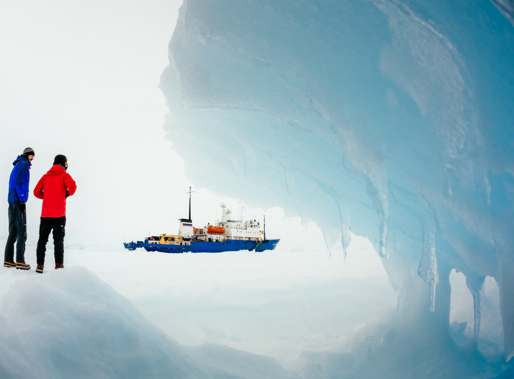 Passengers from the Russian ship MV Akademik Shokalskiy trapped in the ice 1,500 nautical miles south of Hobart, Australia, walk around the ice in this Dec. 31 image provided by Australasian Antarctic Expedition/Footloose Fotography.