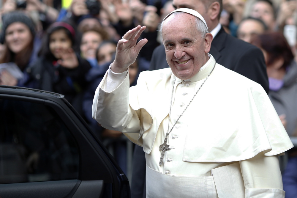 Pope Francis waves as he leaves at the end of his mass at the Church of the Most Holy Name of Jesus in downtown Rome on Jan. 3.