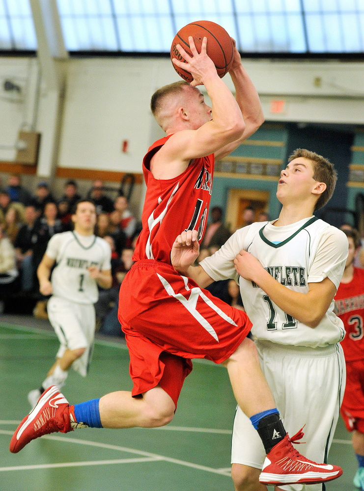 Jake Moody of Wells drives against Milo Belleau of Waynflete during Waynflete's 64-36 victory in a Western Maine Conference game Saturday. Moody needed to score 14 points to reach 1,000 for his career. He scored 13.