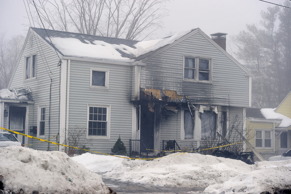 An early-morning fire caused extensive damage to this home at 716 Brighton Ave. in Portland.