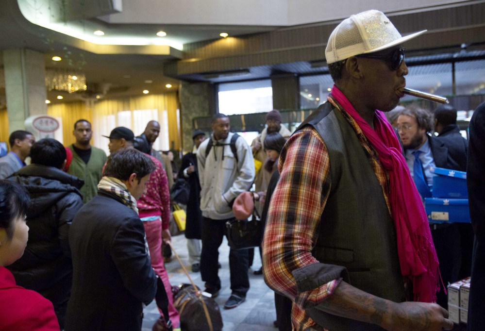 Former NBA basketball star Dennis Rodman and fellow U.S. basketball players arrive at a hotel in Pyongyang, North Korea on Monday.