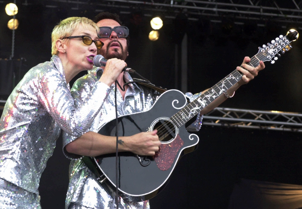 Annie Lennox, left, and Dave Stewart as the Eurythmics performing on stage in 2000 in Germany. The Eurythmics are reuniting to pay tribute to the Beatles.