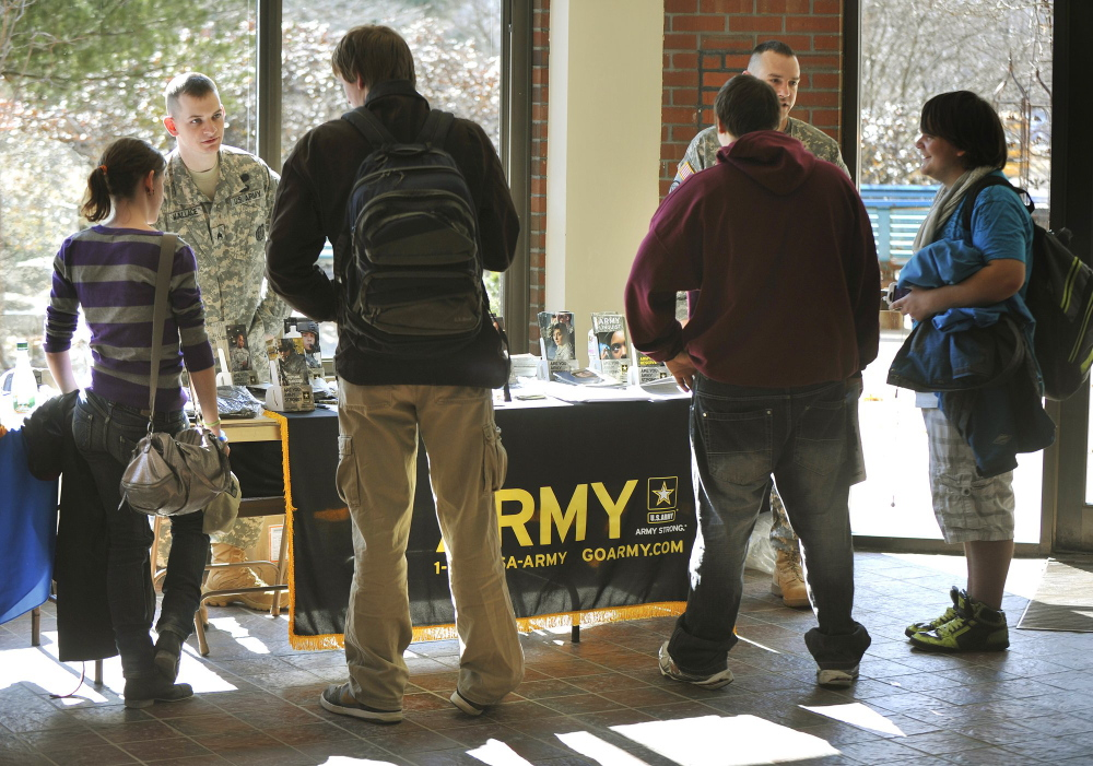 Army recruiters Sgt. Stephen Wallace, left, and Sgt. 1st Class Brandon Didier talk with Portland Arts and Technology High School students during a 2012 job fair. A proposal that would ensure that recruiters are allowed to wear uniforms while visiting schools was defeated during the last legislative session. A similiar version of the bill will be introduced in the session that starts Wednesday.