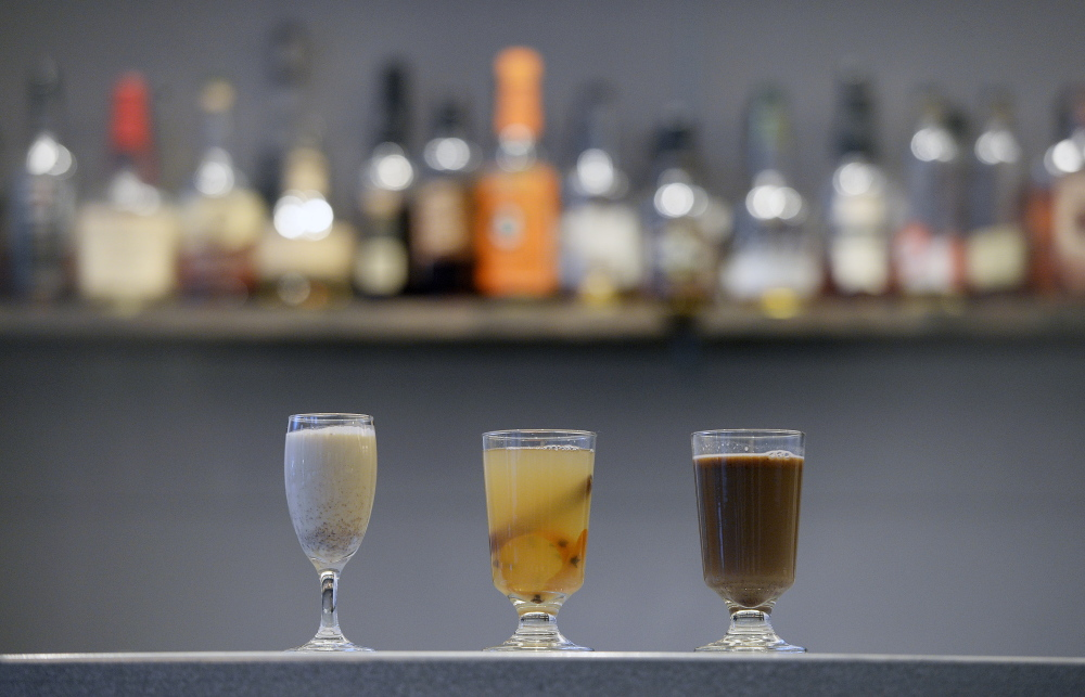 Winter warmers served at the Portland Hunt & Alpine Club include, from left, tequila sherry egg nog, hot toddy and hot buttered rum.