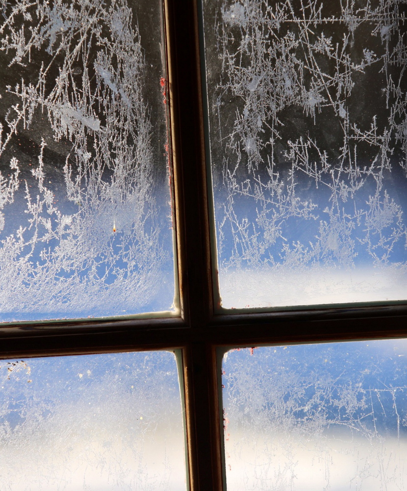 Ice crystals cling to the window of a shed in Scarborough on Tuesday as temperatures hovered in the teens with a fierce wind chill for much of the day.