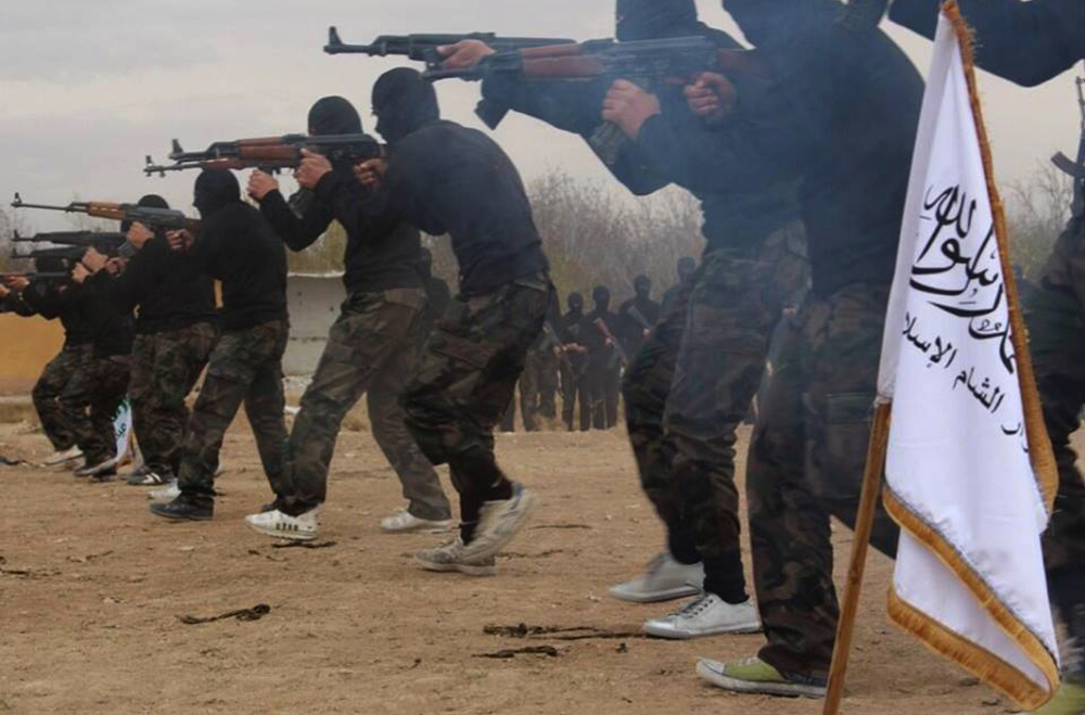 Members of Ahrar al-Sham brigade, one of the Syrian rebel groups, are shown training in an unknown location in Syria, in an undated picture released Nov. 29.