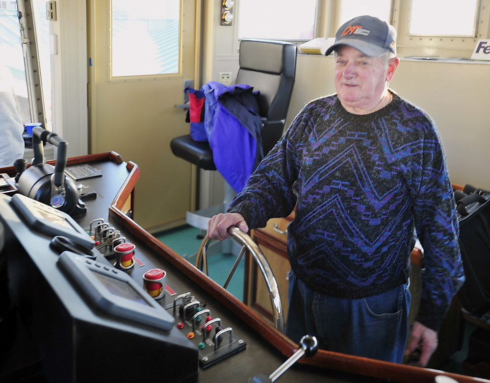 Captain John Medeiros stands at the helm of The Wabanaki as it comes into port. In his years at Casco Bay Lines, Medeiros has delivered other ferries built in Rhode Island – like the Island Romance, and Holiday – when they were new.