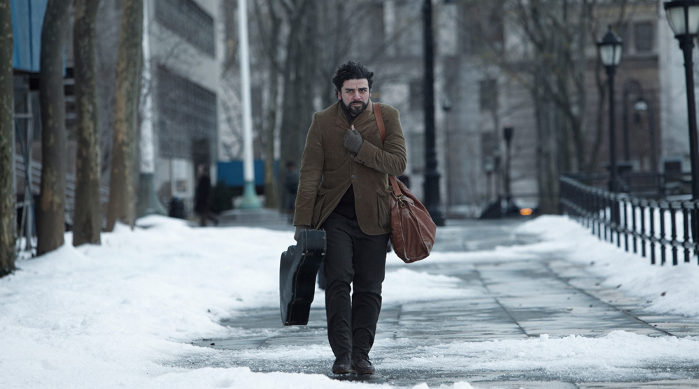 """Oscar Isaac, above, and Carey Mulligan and Justin Timberlake, below, are folk singers trying to make their way in 1961 in New York's Greenwich Village in """"Inside Llewyn Davis."""""""