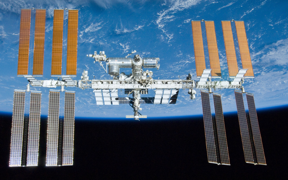 The International Space Station orbits above Earth. On Wednesday, NASA said the White House was poised to announce an extension of the station's lifetime until at least 2024. The previous date was 2020.