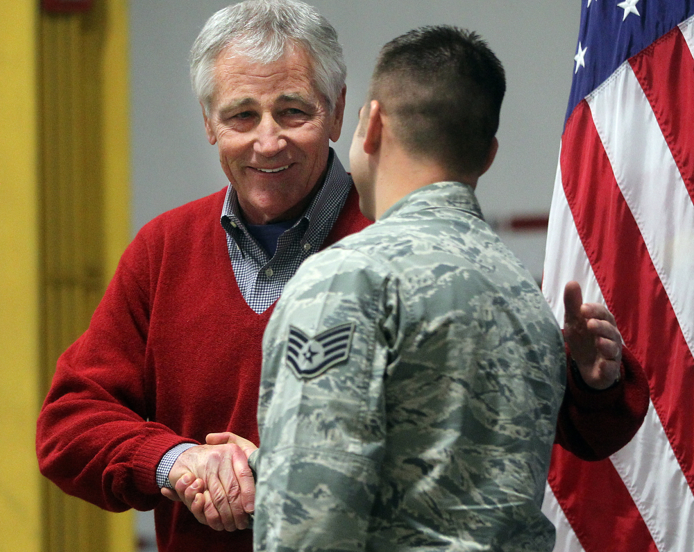 Defense Secretary Chuck Hagel greets an airman from the 20th Air Force 90th Missile Wing on Thursday during a trip to F.E. Warren Air Force Base in Cheyenne, Wyo.