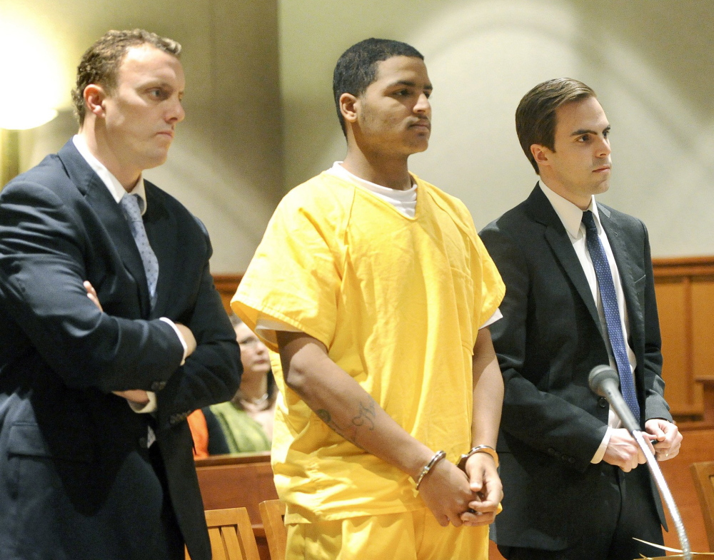 Flanked by attorneys Peter Cyr and Dylan Boyd, Anthony Pratt makes his initial court appearance on April 26, 2013, to face a charge of murder in the death of Margarita Fisenko Scott.
