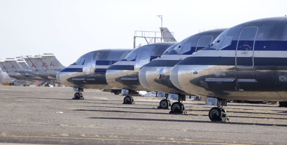 Retired airliners sit parked at the airport in Roswell, N.M. where the dry desert air prevents the aluminum airframe from corroding and spare parts can be harvested or the old jets get chopped up for scrap metal.